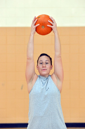 Theresa Irwin lifts her pumpkin above her head for an exercise during the Great Pumpkin Workout at the Paul Derda Recreation Center on Thursday.<br /> October 25, 2012<br /> staff photo/ David R. Jennings