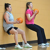 Theresa Irwin, left, and her mother Janet Irwin perform an exercise against the wall of the gym while holding pumpkins during the Great Pumpkin Workout at the Paul Derda Recreation Center on Thursday.<br /> October 25, 2012<br /> staff photo/ David R. Jennings