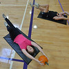 Janet Irwin, front and her daughter Theresa Irwin perform an exercise with pumpkins during the Great Pumpkin Workout at the Paul Derda Recreation Center on Thursday.<br /> October 25, 2012<br /> staff photo/ David R. Jennings