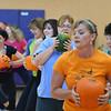 Jean Rosecrans, center, uses her green pumpkin during an exercise at the Great Pumpkin Workout at the Paul Derda Recreation Center on Thursday.<br /> October 25, 2012<br /> staff photo/ David R. Jennings
