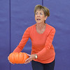 Judi Redington uses a pumpkin for an exercise during the Great Pumpkin Workout at the Paul Derda Recreation Center on Thursday.<br /> October 25, 2012<br /> staff photo/ David R. Jennings