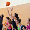Haley Beaty tosses a pumpkin into the air for an exercise during the Great Pumpkin Workout at the Paul Derda Recreation Center on Thursday.<br /> October 25, 2012<br /> staff photo/ David R. Jennings
