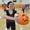Instructor Dawn Keating exercises in the gym with a pumpkin during the Great Pumpkin Workout at the Paul Derda Recreation Center on Thursday.<br /> October 25, 2012<br /> staff photo/ David R. Jennings