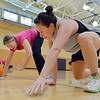 Theresa Irwin, right, rolls a pumpkin with her mother Theresa Irwin during the Great Pumpkin Workout at the Paul Derda Recreation Center on Thursday.<br /> October 25, 2012<br /> staff photo/ David R. Jennings
