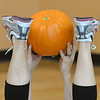 A Great Pumpkin Workout participant passes a pumpkin between her feet and hands at the Paul Derda Recreation Center on Thursday.<br /> October 25, 2012<br /> staff photo/ David R. Jennings