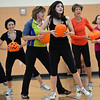 Great Pumpkin Workout participants Haley Beaty, center, Dawn Keating, left, Bette Erickson, and Janet Irwin perform an exercise across the gym floor at the Paul Derda Recreation Center on Thursday.<br /> October 25, 2012<br /> staff photo/ David R. Jennings