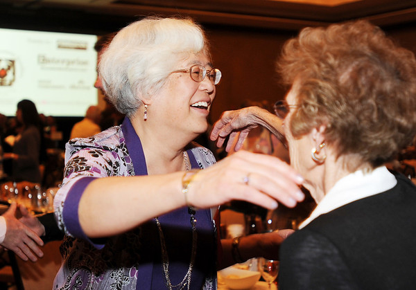 Heart of Broomfield Education winner Diane Etsuko Johnson greets Jane Spain during the  2012 Heart of Broomfield Award ceremony at the Omni Interlocken Resort on Monday.<br /> <br /> <br /> April 9, 2012 <br /> staff photo/ David R. Jennings
