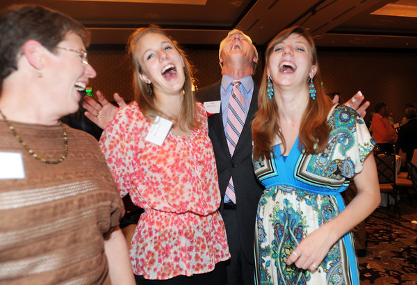 Heart of Broomfield Angel award winner Greg Blanchard, second right, laughs with his family, wife, Diane, daughters Micaela, and Jessica after the  2012 Heart of Broomfield Award ceremony at the Omni Interlocken Resort on Monday.<br /> <br /> <br /> April 9, 2012 <br /> staff photo/ David R. Jennings
