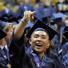 Danny Lee signals to his family during Legacy High School's graduation ceremony at Coors Event Center at the University of Colorado on Monday.<br /> <br /> May 14, 2012 <br /> staff photo/ David R. Jennings