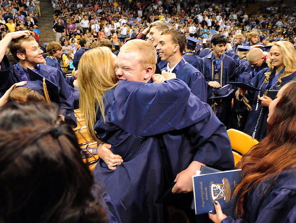 Megan Neal, left, hugs Ty Overboe after Legacy High School's graduation ceremony at Coors Event Center at the University of Colorado on Monday.<br /> <br /> May 14, 2012 <br /> staff photo/ David R. Jennings
