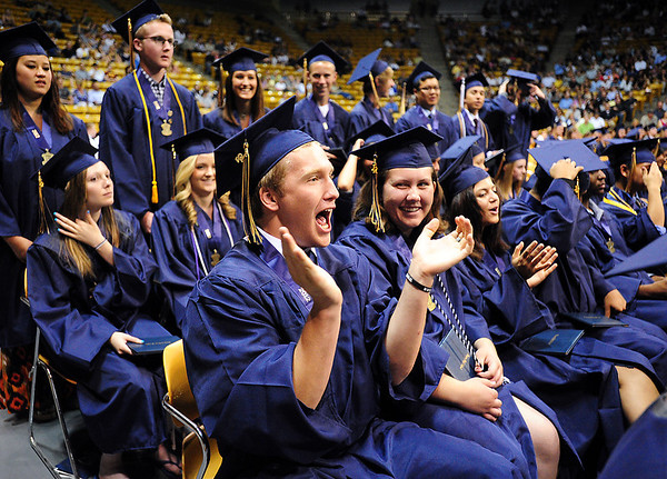 Wyatt Swicegood gives a cheer for a fellow graduate during Legacy High School's graduation ceremony at Coors Event Center at the University of Colorado on Monday.<br /> <br /> May 14, 2012 <br /> staff photo/ David R. Jennings
