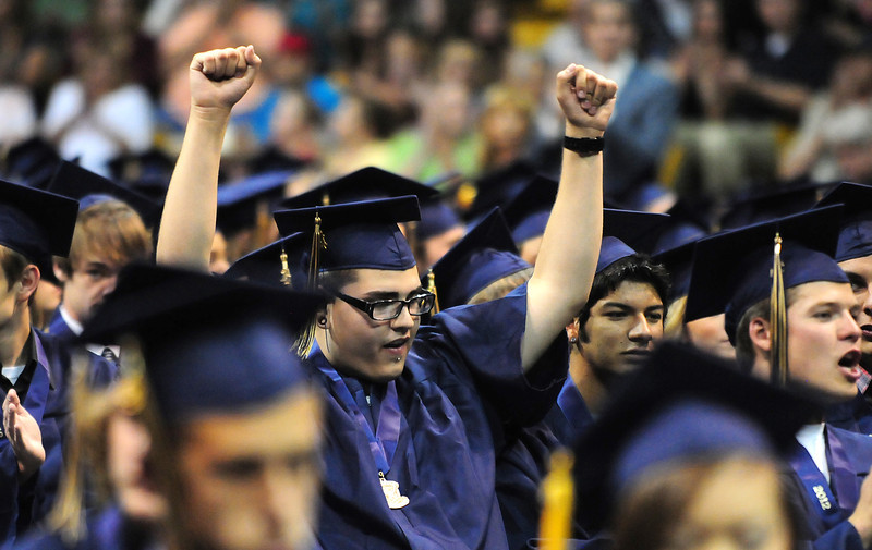 Jeremy Chavez cheers during Legacy High School's graduation ceremony at Coors Event Center at the University of Colorado on Monday.<br /> <br /> May 14, 2012 <br /> staff photo/ David R. Jennings