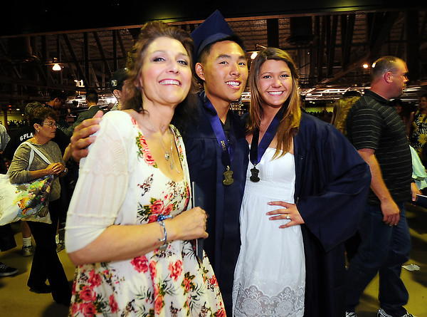 Art teacher Kim Williams, left, poses with Danny Lee and her daughter Autumn after Legacy High School's graduation ceremony at Coors Event Center at the University of Colorado on Monday.<br /> <br /> May 14, 2012 <br /> staff photo/ David R. Jennings