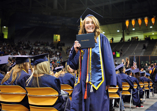 Leanne Ertle shows her diploma during Legacy High School's graduation ceremony at Coors Event Center at the University of Colorado on Monday.<br /> <br /> May 14, 2012 <br /> staff photo/ David R. Jennings