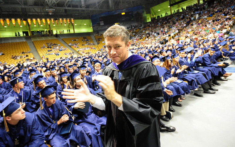 Adams 12 superintendent Christopher Gdowski congratulates the class of 2012 during Legacy High School's graduation ceremony at Coors Event Center at the University of Colorado on Monday.<br /> <br /> May 14, 2012 <br /> staff photo/ David R. Jennings