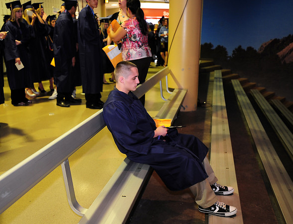 Jay Hoylman sits in the top bleaches waiting for  Legacy High School's graduation ceremony to begin at Coors Event Center at the University of Colorado on Monday.<br /> <br /> May 14, 2012 <br /> staff photo/ David R. Jennings
