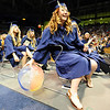 A graduate grabs a beach ball being tossed around during Legacy High School's graduation ceremony at Coors Event Center at the University of Colorado on Monday.<br /> <br /> May 14, 2012 <br /> staff photo/ David R. Jennings