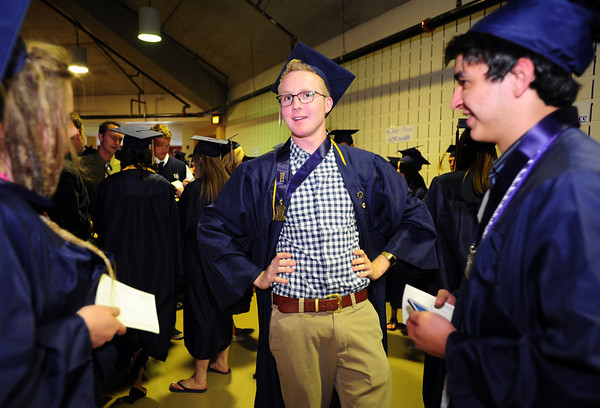 William Vickroy stricks a pose while talking to fellow graduates Erin Swaney, left, and Schyler Vargus before Legacy High School's graduation ceremony at Coors Event Center at the University of Colorado on Monday.<br /> <br /> May 14, 2012 <br /> staff photo/ David R. Jennings