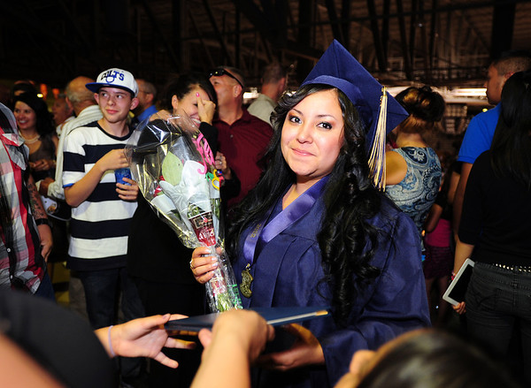 Gina Perezcelebrates with her family after Legacy High School's graduation ceremony at Coors Event Center at the University of Colorado on Monday.<br /> <br /> May 14, 2012 <br /> staff photo/ David R. Jennings