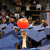 A graduate gives a tip to one of the balloons released during Legacy High School's graduation ceremony at Coors Event Center at the University of Colorado on Monday.<br /> <br /> May 14, 2012 <br /> staff photo/ David R. Jennings