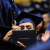 A Legacy graduate shows his family his diploma with a thumbs up during Legacy High School's graduation ceremony at Coors Event Center at the University of Colorado on Monday.<br /> <br /> May 14, 2012 <br /> staff photo/ David R. Jennings