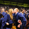 Megan Neal, left, kisses Ty Overboe after Legacy High School's graduation ceremony at Coors Event Center at the University of Colorado on Monday.<br /> <br /> May 14, 2012 <br /> staff photo/ David R. Jennings