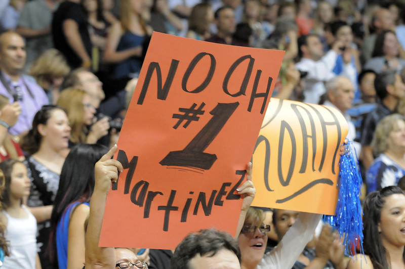 The family of Noah Martinez hold up signs for him to see during Legacy High School's graduation ceremony at Coors Event Center at the University of Colorado on Monday.<br /> <br /> May 14, 2012 <br /> staff photo/ David R. Jennings