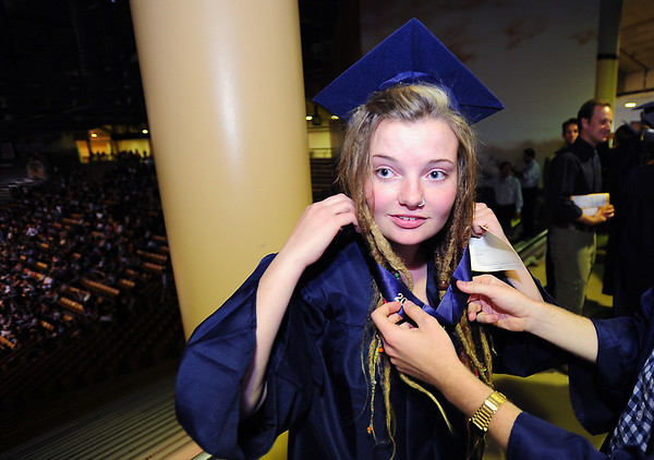 Erin Swaney prepares for the Legacy High School's graduation ceremony at Coors Event Center at the University of Colorado on Monday.<br /> <br /> May 14, 2012 <br /> staff photo/ David R. Jennings