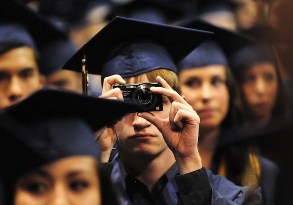 A Legacy graduate takes pictures during Legacy High School's graduation ceremony at Coors Event Center at the University of Colorado on Monday.<br /> <br /> May 14, 2012 <br /> staff photo/ David R. Jennings