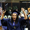 Alyssa Goebel cheers after receiving her diploma during Legacy High School's graduation ceremony at Coors Event Center at the University of Colorado on Monday.<br /> <br /> May 14, 2012 <br /> staff photo/ David R. Jennings