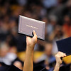 Legacy graduates hold up thier diplomas during Legacy High School's graduation ceremony at Coors Event Center at the University of Colorado on Monday.<br /> <br /> May 14, 2012 <br /> staff photo/ David R. Jennings