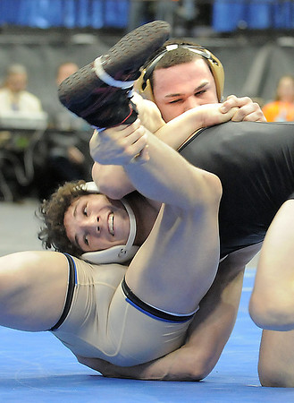 Broomfield High's Phil Downing, above, wrestles Roosevelt High's Jace Lopez in the 138 lbs 4A championship match during the 2012 State Wrestling Tournament Saturday at the Pepsi Center in Denver.<br /> February 18, 2012<br /> staff photo/ David R. Jennings