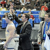 Broomfield High's Nick Babcock has his hand raised in celebration by coach Joe Pereira after defeating Erie High's Clay Bunker in the 152 lbs 4A championship match during the 2012 State Wrestling Tournament Saturday at the Pepsi Center in Denver.<br /> February 18, 2012<br /> staff photo/ David R. Jennings