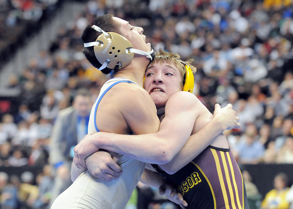 Broomfield High's Drew Romero collides with Windsor High's Jonathan Lewis in the 106 lbs 4A championship match during the 2012 State Wrestling Tournament Saturday at the Pepsi Center in Denver.<br /> February 18, 2012<br /> staff photo/ David R. Jennings