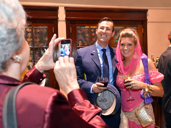 "Nick and Shanda Reifschnider have their picture taken during the 48th annual Bal Swan Ball with the 1960's theme of ""Peace, Love and Bal Swan"" at the Omni Interlocken Hotel Resort on Saturday.<br /> March 2, 2013<br /> staff photo/ David R. Jennings"