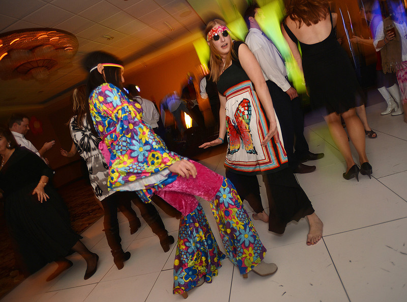 "Clarissa Villarreal, left, and Janet Gonzalez dance during the 48th annual Bal Swan Ball with the 1960's theme of ""Peace, Love and Bal Swan"" at the Omni Interlocken Hotel Resort on Saturday.<br /> March 2, 2013<br /> staff photo/ David R. Jennings"