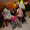 """Clarissa Villarreal, left, and Janet Gonzalez dance during the 48th annual Bal Swan Ball with the 1960's theme of """"Peace, Love and Bal Swan"""" at the Omni Interlocken Hotel Resort on Saturday.<br /> March 2, 2013<br /> staff photo/ David R. Jennings"""