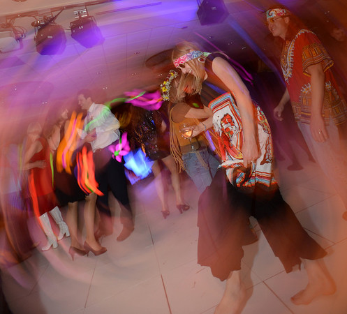 "Janet Gonzalez, a Bal Swan teacher, dances during the 48th annual Bal Swan Ball with the 1960's theme of ""Peace, Love and Bal Swan"" at the Omni Interlocken Hotel Resort on Saturday.<br /> March 2, 2013<br /> staff photo/ David R. Jennings"