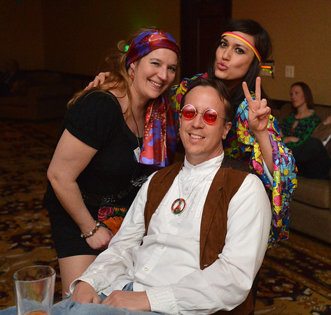"Delois and Jeremy Meyer pose for a picture with teacher Clarissa Villarreal  during the 48th annual Bal Swan Ball with the 1960's theme of ""Peace, Love and Bal Swan"" at the Omni Interlocken Hotel Resort on Saturday.<br /> March 2, 2013<br /> staff photo/ David R. Jennings"