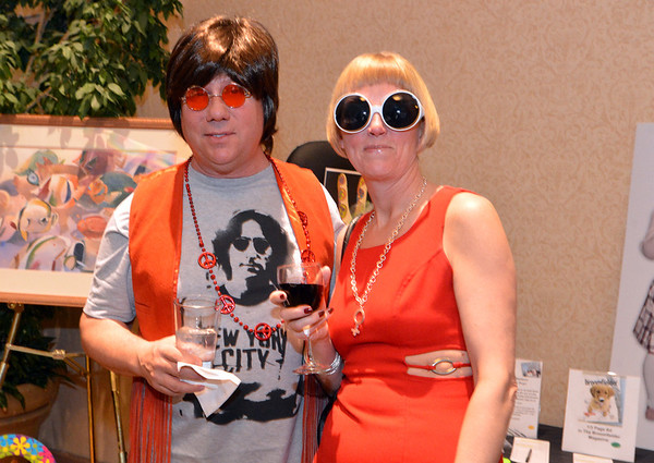 "Dennis and Debra Paul attended the 48th annual Bal Swan Ball with the 1960's theme of ""Peace, Love and Bal Swan"" at the Omni Interlocken Hotel Resort on Saturday.<br /> March 2, 2013<br /> staff photo/ David R. Jennings"