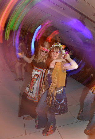 "Teachers Janet Gonzalez, left, and Sar Pringle dance during the 48th annual Bal Swan Ball with the 1960's theme of ""Peace, Love and Bal Swan"" at the Omni Interlocken Hotel Resort on Saturday.<br /> March 2, 2013<br /> staff photo/ David R. Jennings"