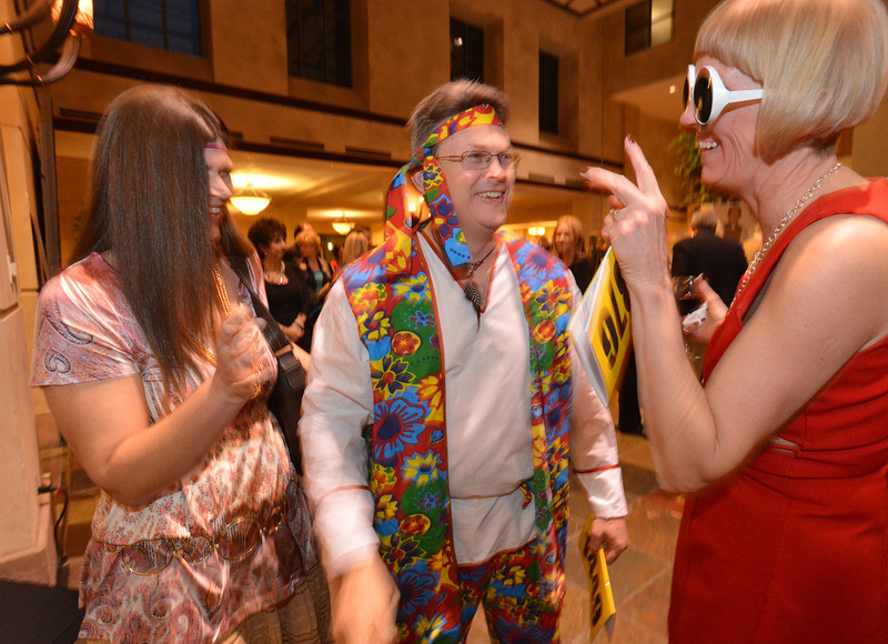 "Raquel and Bill Smellage, left, chat with Debra Paul during the 48th annual Bal Swan Ball with the 1960's theme of ""Peace, Love and Bal Swan"" at the Omni Interlocken Hotel Resort on Saturday.<br /> March 2, 2013<br /> staff photo/ David R. Jennings"