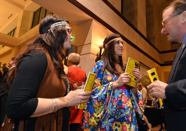 "Lacey Guerin, left, Clarissa Villarreal and Tom Ladtkow chat during the 48th annual Bal Swan Ball with the 1960's theme of ""Peace, Love and Bal Swan"" at the Omni Interlocken Hotel Resort on Saturday.<br /> March 2, 2013<br /> staff photo/ David R. Jennings"