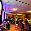 "Attendees watch a video during the 48th annual Bal Swan Ball with the 1960's theme of ""Peace, Love and Bal Swan"" at the Omni Interlocken Hotel Resort on Saturday.<br /> March 2, 2013<br /> staff photo/ David R. Jennings"