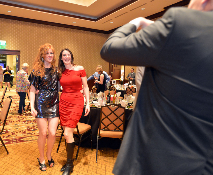 "Mindy Barber, left, and Erin Boyle have their picture taken during the 48th annual Bal Swan Ball with the 1960's theme of ""Peace, Love and Bal Swan"" at the Omni Interlocken Hotel Resort on Saturday.<br /> March 2, 2013<br /> staff photo/ David R. Jennings"
