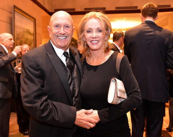 """The night's auctioneer Sodie Carraway and his wife Bonnie during the 48th annual Bal Swan Ball with the 1960's theme of """"Peace, Love and Bal Swan"""" at the Omni Interlocken Hotel Resort on Saturday.<br /> March 2, 2013<br /> staff photo/ David R. Jennings"""