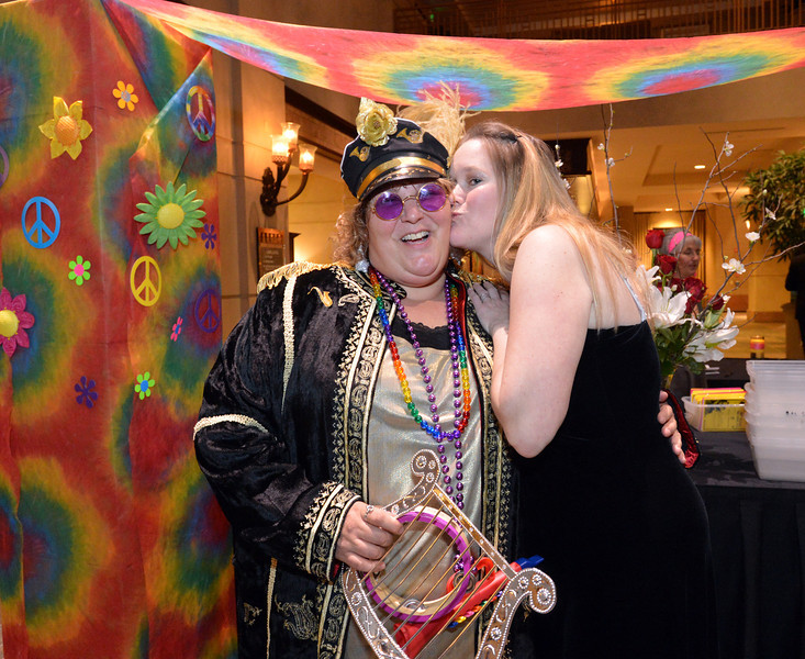 "Bal Swan music teacher Marcie Frahm, left, dressed as Sgt. Pepper, and development director Sunny Justice during the 48th annual Bal Swan Ball with the 1960's theme of ""Peace, Love and Bal Swan"" at the Omni Interlocken Hotel Resort on Saturday.<br /> March 2, 2013<br /> staff photo/ David R. Jennings"