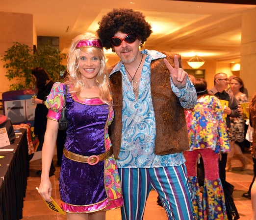 """Gina and Glenn Herrmann attended the 48th annual Bal Swan Ball with the 1960's theme of """"Peace, Love and Bal Swan"""" at the Omni Interlocken Hotel Resort on Saturday.<br /> March 2, 2013<br /> staff photo/ David R. Jennings"""