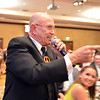 "Auctioneer Sodie Carraway takes bids from attendees during the 48th annual Bal Swan Ball with the 1960's theme of ""Peace, Love and Bal Swan"" at the Omni Interlocken Hotel Resort on Saturday.<br /> March 2, 2013<br /> staff photo/ David R. Jennings"
