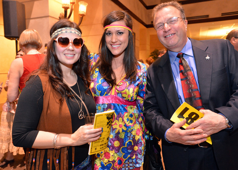 "Lacey Guerin, left, Clarissa Villarreal and Tom Ladtkow attended the 48th annual Bal Swan Ball with the 1960's theme of ""Peace, Love and Bal Swan"" at the Omni Interlocken Hotel Resort on Saturday.<br /> March 2, 2013<br /> staff photo/ David R. Jennings"